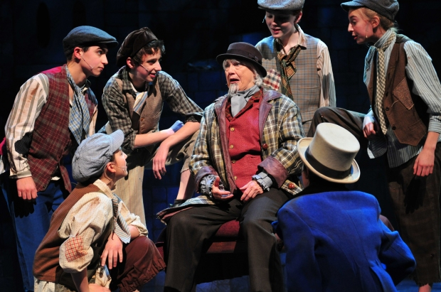 "Jane Staab as Fagin and her crew of juvenile pickpockets in ""Oliver."" Photo: Gary Ng."
