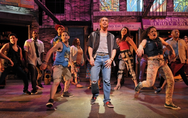 Diego Klock-Perez as Usnavi (center) in a scene from the SpeakEasy Stage Company production of IN THE HEIGHTS, extended now thru June 16 at the Stanford Calderwood Pavilion at the Boston Center for the Arts, 527 Tremont Street in Boston's South End.  Tix/Info:  617-933-8600 or www.SpeakEasyStage.com.  Photo:  Craig Bailey/Perspective Photo.
