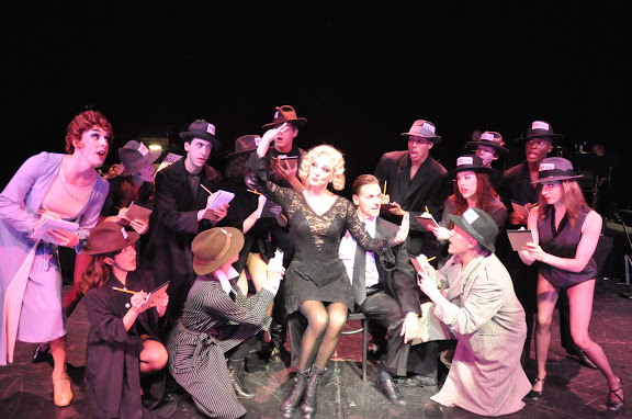 "Angie Schworer as Roxie and Rick Pessagno as Billy Flynn give the press the scoop in ""Chicago"" at Reagle Music Theatre of Greater Boston June 13-23, 617 Lexington Street, Waltham. (Photo: Herb Philpott)"