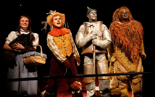 Danielle Bowen (Dorothy), Nigel (Toto), Paul Sabala (Scarecrow), Joe Moeller (Tinman), and Lance Roberts (Lion) in North Shore Music Theatre's production of THE WIZARD OF OZ running through August 4, 2013. Photos by Paul Lyden