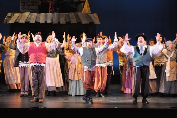 "Scott Wahle as Tevye leads the company in ""Tradition."" Photo (c) Herb Philpott."