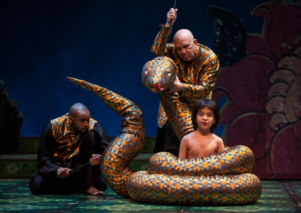 Timothy Wilson (ensemble), Thomas Derrah (Kaa), and Akash Chopra (Mowgli) in Tony Award winner Mary Zimmerman's new musical adaptation of The Jungle Book. Photo: Liz Lauren