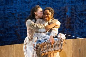 From left: Aubin Wise as Nettie and Lovely Hoffman as Celie in a scene from the SpeakEasy Stage Company production of THE COLOR PURPLE. Photo: Glenn PerryPhotography.