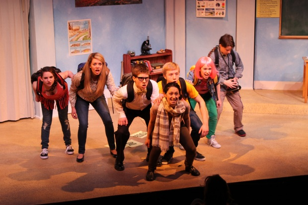 Sima Kasten as 'Maddie', Kaleigh Ronan as 'Judy', Colin Budzyna as 'Brenton', Ethan Koss-Smith as 'Sam', Margaret McFadden as 'Kelsey', Jonah Yannis as 'Ronnie' and (front/center) Carly Kastel as Ms. Rasmussen in Boston Children's Theatre's World Premiere musical THE HOMEWORK MACHINE based on the best selling book by Dan Gutman. Photo by Toby Schine.