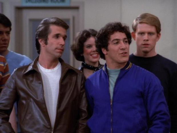 "Eddie Mekka as Carmine with Henry Winkler as Fonzie in an episode of ""Happy Days."""