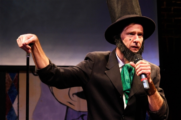 "Dominic Conti as stand-up comic Abe Lincoln in the Reduced Shakespeare Company's ""The Complete History of Humor (abridged)."""
