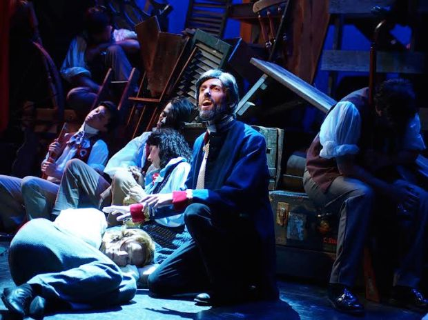 "Michael Warner as Jean Valjean sings ""Bring Him Home"" in the Company Theatre's ""Les Miserables."" Photo:  Zoe Bradford"