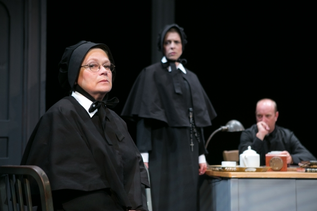 "Karen MacDonald (Sister Aloysius), Kathryn Myles (Sister James), and Gabriel Kuttner (Father Flynn) in the Stoneham Theatre's ""Doubt: A Parable."". Photo credit: Mark S. Howard."