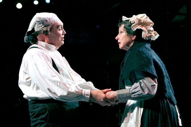 "David Coffee as Ebenzer Scrooge and Cheryl McMahon as Mrs. Dilber in ""A Christmas Carol."" Photo: Paul Lyden"