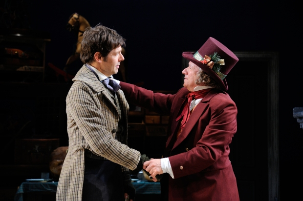 Stephen Thorne as Bob Cratchit and Stephen Berenson as Ebenezer Scrooge in Charles Dickens' A Christmas Carol at Trinity Rep, directed by Curt Columbus. Set design by Deb O,  costume design by Toni Spadafora, lighting design by Josh Epstein. Photo Mark Turek.