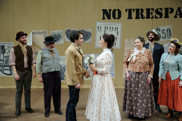 Charlie Thurston as Curly and Rachael Warren as Laurey (center) with the cast of Rodgers & Hammerstein's Oklahoma! directed and choreographed by Richard and Sharon Jenkins at Trinity Rep. Set and lighting design by Eugene Lee and costume design by Toni Spadafora. Photo Mark Turek.