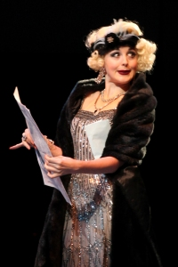 Emily Stockdale as Lina Lamont in North Shore Music Theatre's production of SINGIN' IN THE RAIN playing thru August 28. Photo © Paul Lyden.