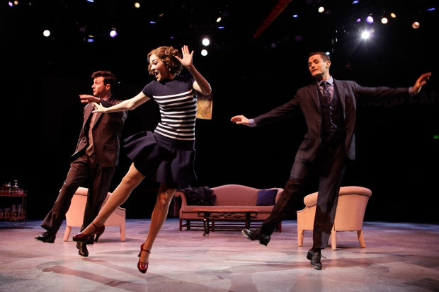 Sean McGibbon (Cosmo Brown), Tessa Grady (Kathy Selden), and Mark Evans (Don Lockwood) in North Shore Music Theatre's production of SINGIN' IN THE RAIN playing thru August 28. Photo © Paul Lyden.