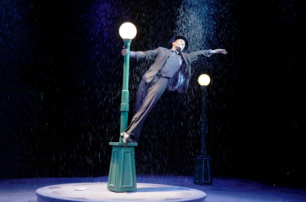 Mark Evans as Don Lockwood in North Shore Music Theatre's production of SINGIN' IN THE RAIN playing thru August 28. Photo © Paul Lyden.