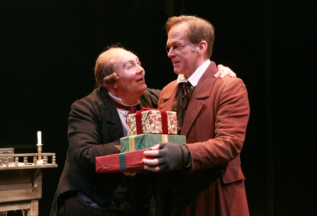 David Coffee (Ebenezer Scrooge) and Russell Garrett (Bob Cratchit) in A CHRISTMAS CAROL at North Shore Music Theatre - Dec 9 - 23. Photo©Paul Lyden